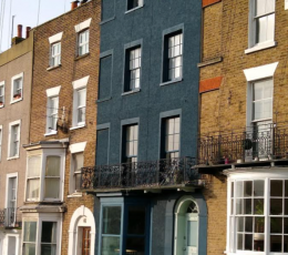 Row of houses with middle house painted in dark blue colour