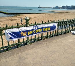The bin is over there banner